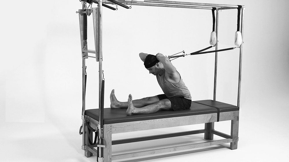 Gratz Gallery | Benjamin Degenhardt using the Neck Stretcher For Spine Stretch on the Cadillac