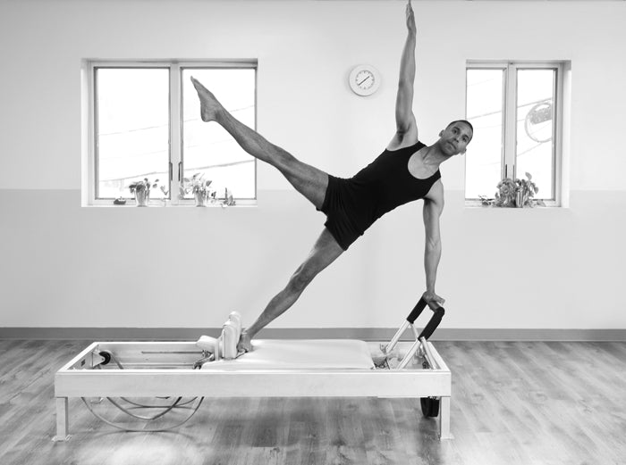 Gratz Gallery | Brett Howard performing the Star exercise on the Universal Reformer