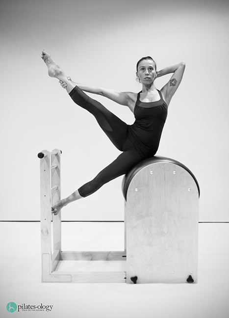 Gratz Gallery | Gloria Gasperi performing the Side-Sit Up exercise on the Ladder Barrel