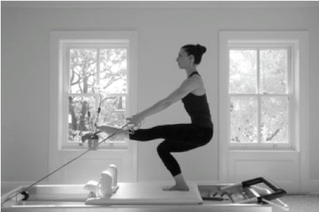 Gratz Gallery | Ilaria Cavagna performing Russian Squats on the Universal Reformer