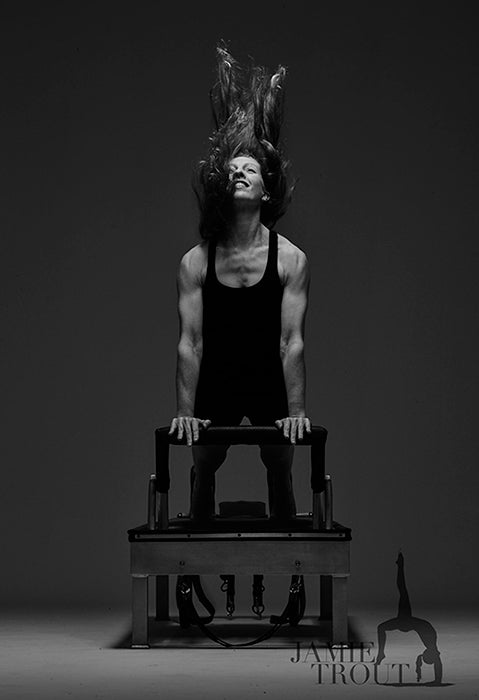 Gratz Gallery | Jamie Trout performing the Up Stretch exercise on the Universal Reformer