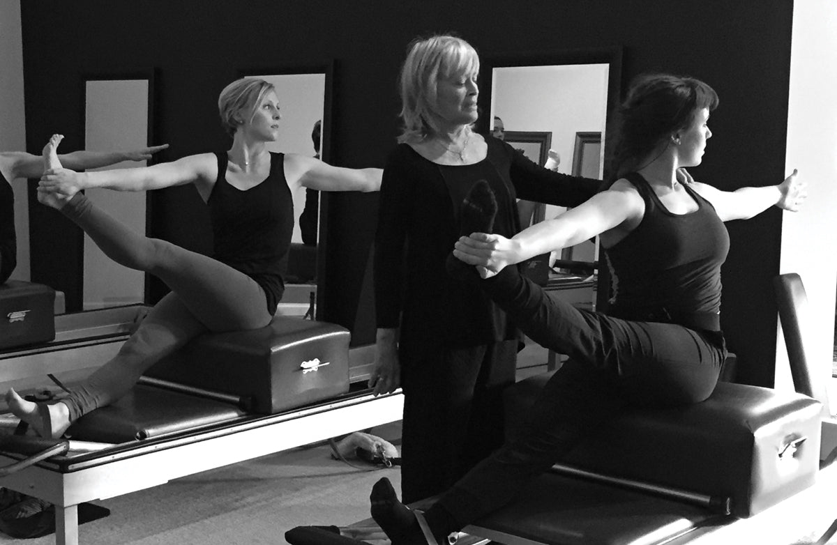 Gratz Gallery | Mari Winsor teaching an exercise on the Universal Reformer