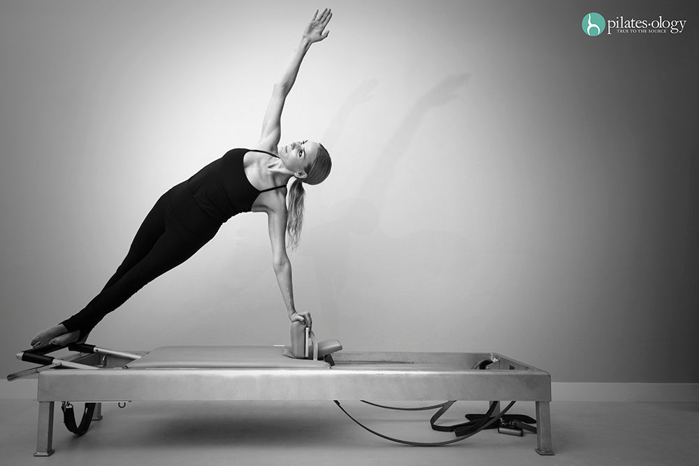 Gratz Gallery | Susanna Foustok performing the Snake Twist exercise on the Universal Reformer