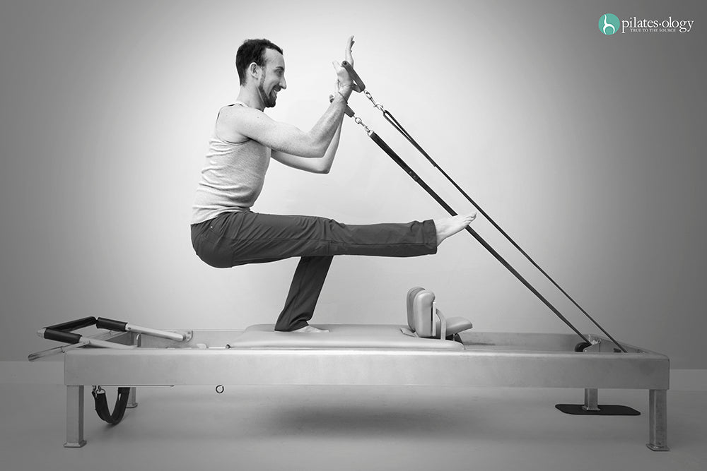 Gratz Gallery | Jon Scott Owen performing the Russian Squats exercise on the Universal Reformer