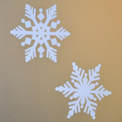 "4 Pack of large 8"" snowflake white window decal clings. Our snowflake window clings do not melt, crack or fade. Available in assorted sizes and quantities."