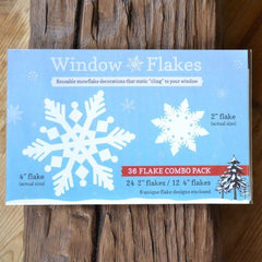 "36 Snowflake Pack of white snowflake decals. This best selling snowflake cling pack contains: 12, 4"" + 24, 2"" snowflake decals. Larger sizes also available."