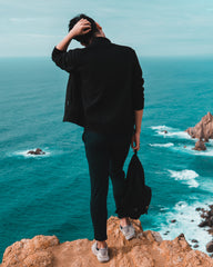 Confused man overlooking ocean wondering about blog content