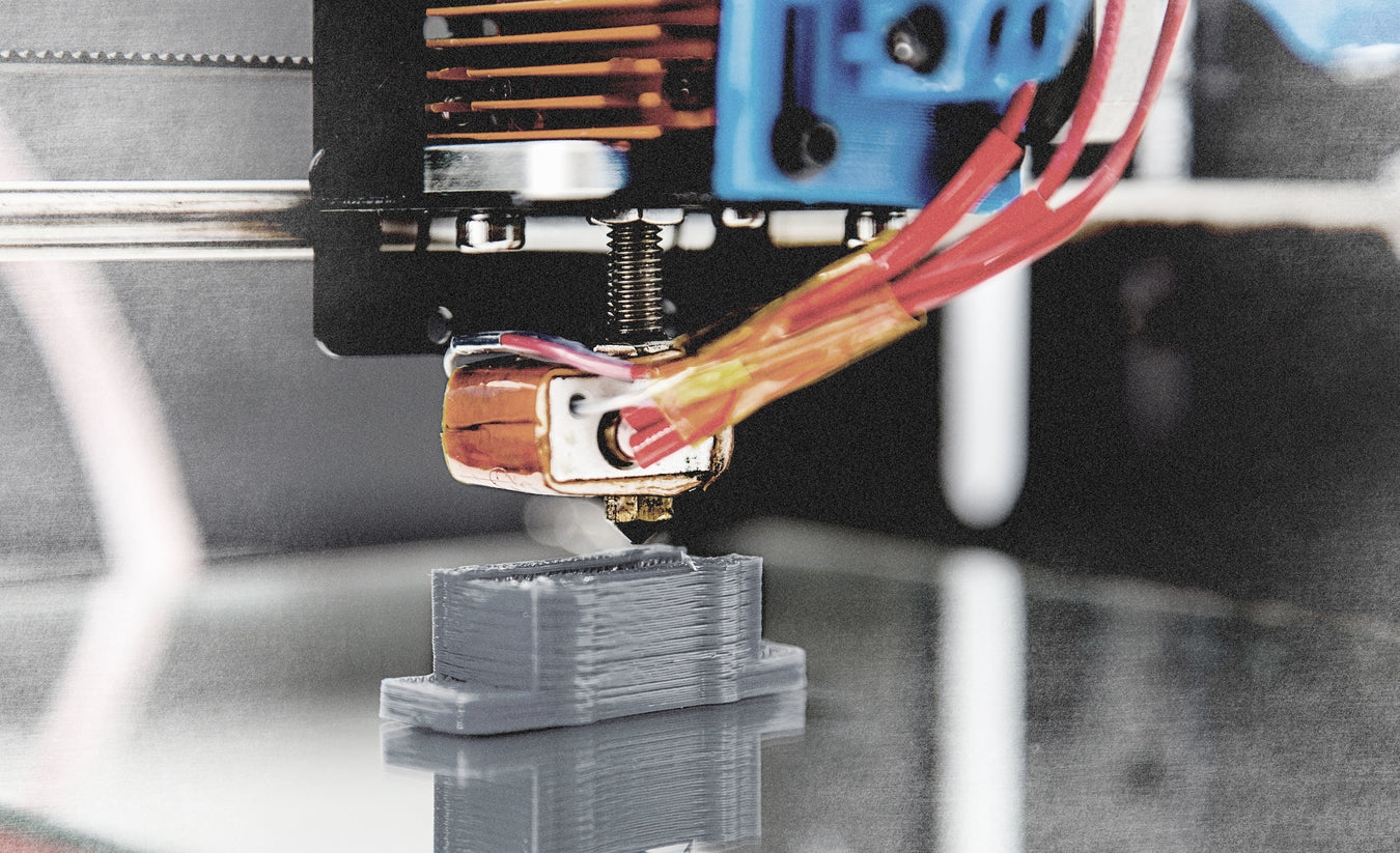 close up photo of 3D printer creating a new part in the chamber