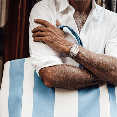 man traveling with luxury watch