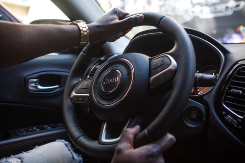 man driving with luxury watch