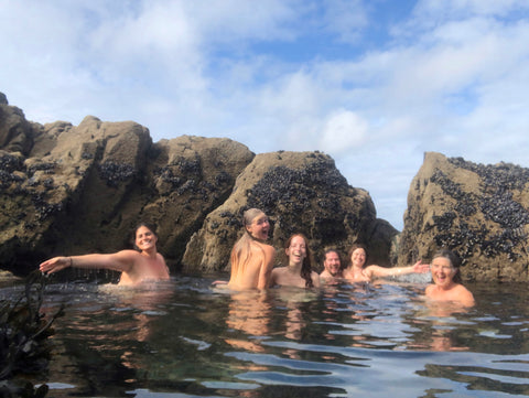 Group of Wild Swimmers naked in a Secret Swim Spot of a Sea Pool in Cornwall UK