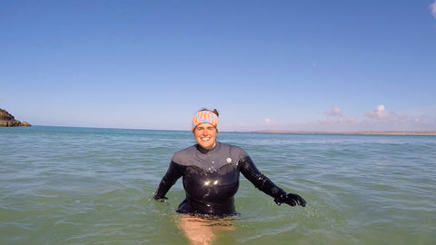 Open Water Swimmer in sea Cornwall with long sleeve woman swimsuit