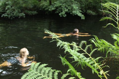 Two women outdoor swimming in a British river