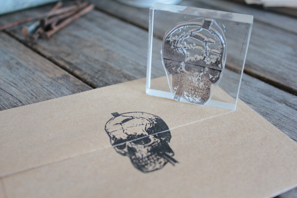 Human Skull with Iron Bar Impaled 2 x 2 Inch Stamp