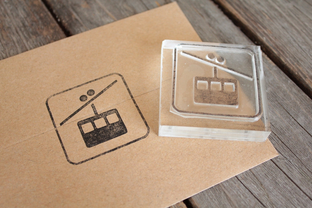 Skiing Gondola Sign 2 x 2 Inch Stamp