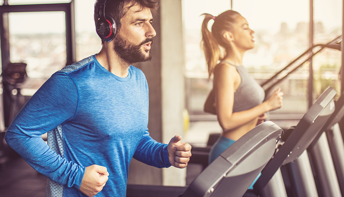 Woman and man practicing excessive cardio to lose weight