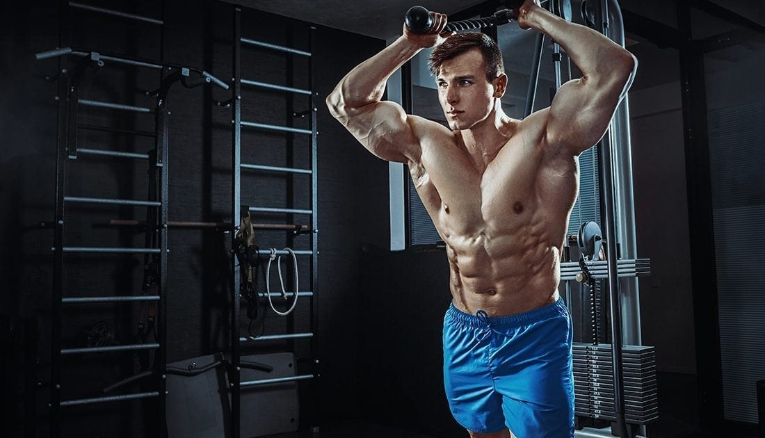 Muscular & Shredded male practicing feeder workouts using light weight