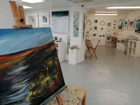 Image of Back Road Artworks gallery in St Ives, painting on a easel