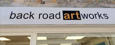 Image of Back Road Artworks sign above the door