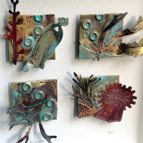 Metal seaweed & sea creatures in copper & brass framed as a picture handmade by Sharon McSwiney