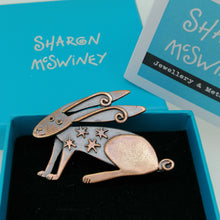 Load image into Gallery viewer, Copper coloured hare brooch with stars on its body handmade by Sharon McSwiney in a gift box