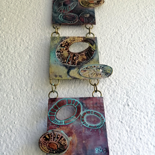 Mini metalwork wall panel with etched limpet designs by Sharon McSwiney
