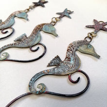 Load image into Gallery viewer, brass seahorse with starfish wall hanging handmade by Sharon McSwiney