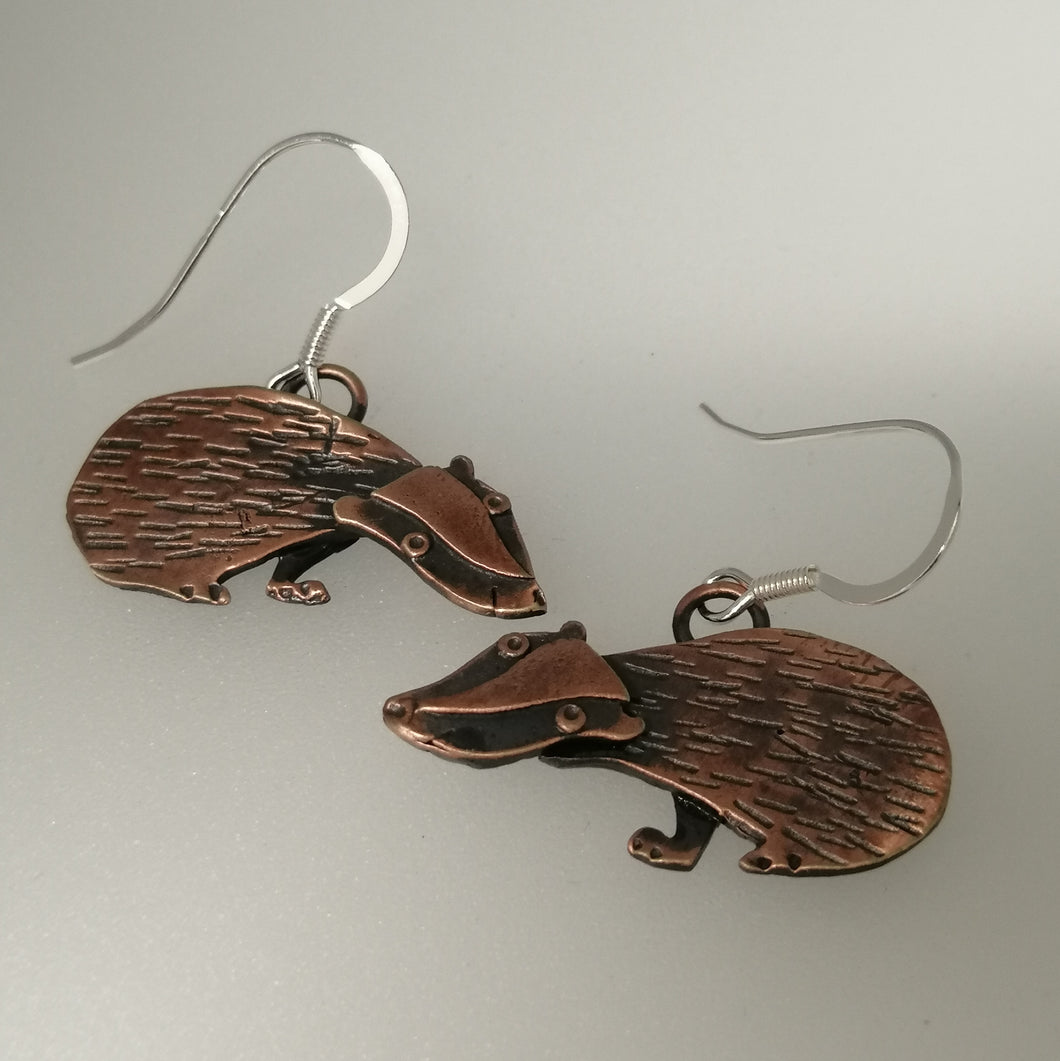 Badger earrings in a copper finish with silver hooks handmade by Sharon McSwiney