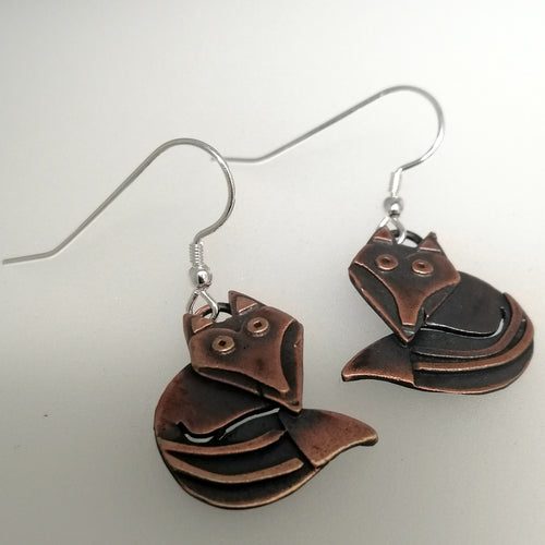 Fox earrings in a copper finish with silver hooks handmade by Sharon McSwiney