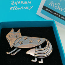 Load image into Gallery viewer, Fox brooch with stars on its body in a copper finish handmade by Sharon McSwiney in a gift box