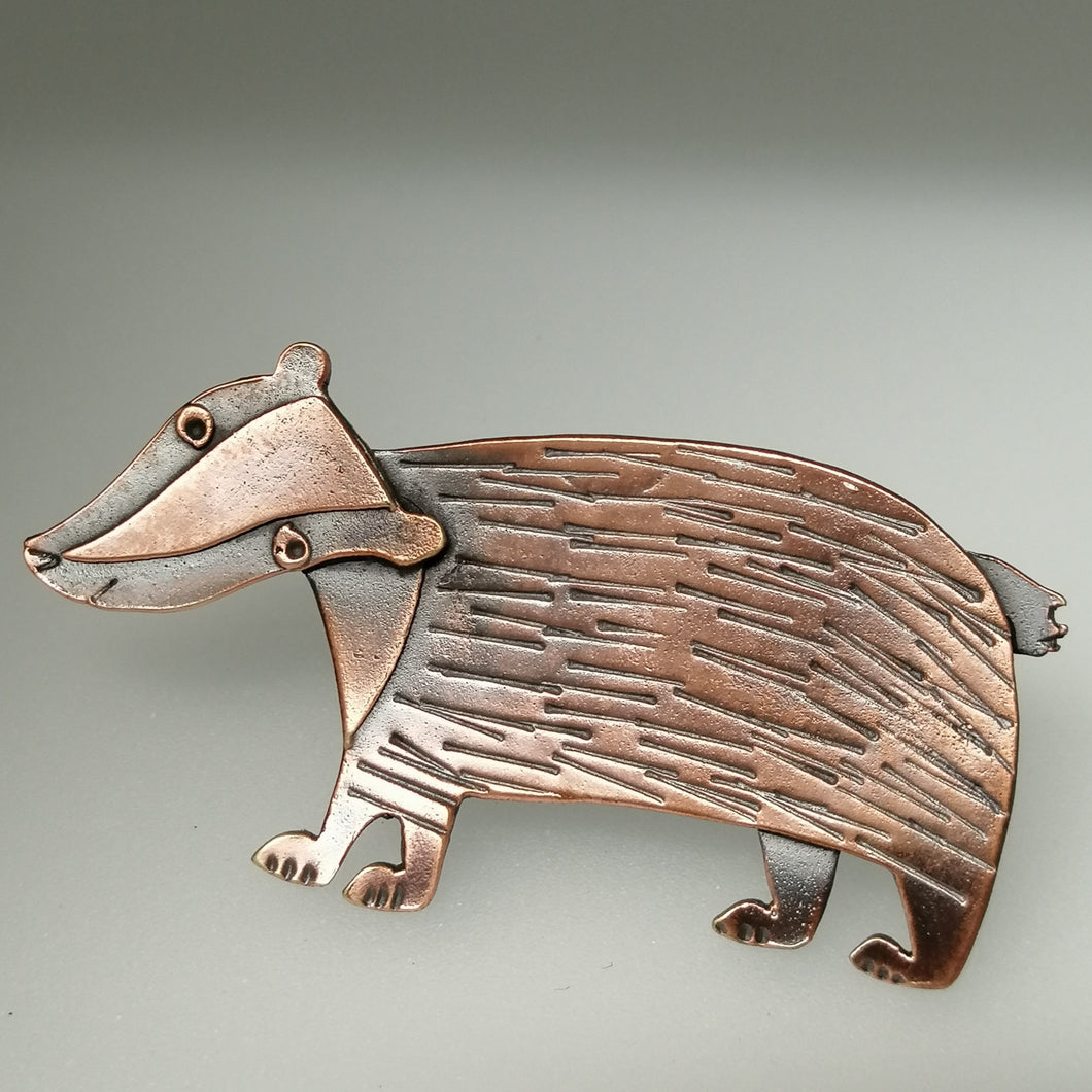 badger brooch in a copper finish handmade by Sharon McSwiney  in a gift box