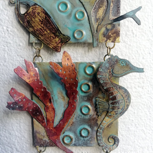 Metalwork wall panel with 3 sections featuring seaweed, a seahorse & mermaids purse handmade by Sharon McSwiney