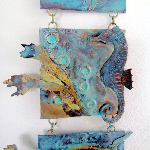 Metalwork long wall panel in copper & brass featuring seahorse with seaweed handmade by Sharon McSwiney