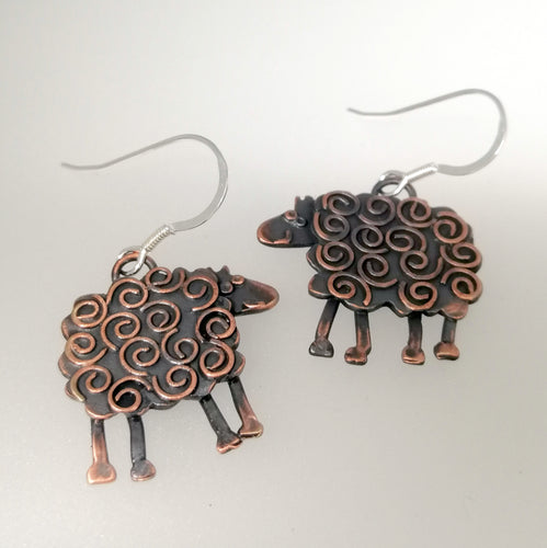 swirly sheep drop earrings in a copper finish handmade by Sharon McSwiney