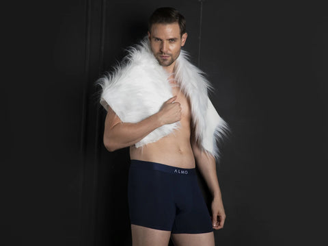 man in cotton scarf and in almo rico solid organic cotton trunks