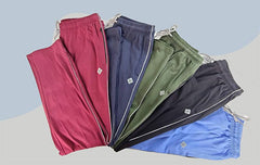 picture of many trackpants in red, blue, green, black and light blue color