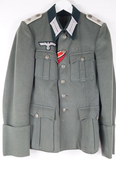 Wehrmacht Nahkampfspange-recipient, named. Uniform and Cap WW2 German
