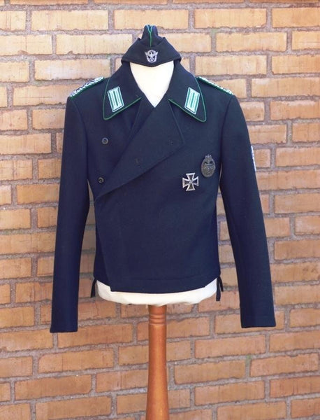 *PRICE ON REQUEST* Extremely rare Polizei Panzerjacke and sidecap for an officer. Perfect condition!