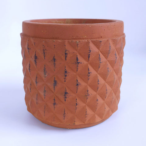 terracotta geometric plant pot on white background