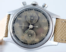 Load image into Gallery viewer, Tissot, Ref. No. 6216-3. Made in the 1950s and sold by Galli Uhren in Zürich, Switzerland.  Fine, water resistant, stainless radium dial steel wristwatch with round button chronograph, registers.