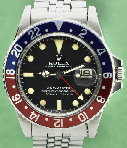 Rolex, Oyster Perpetual, GMT Master, Superlative Chronometer, Officially Certified,  Ref. 1675. Made in Switzerland . Fine, two time zone, center seconds, self-winding, water-resistant, stainless steel wristwatch with date, 24-hour bezel and hand and a stainless steel Rolex riveted bracelet.