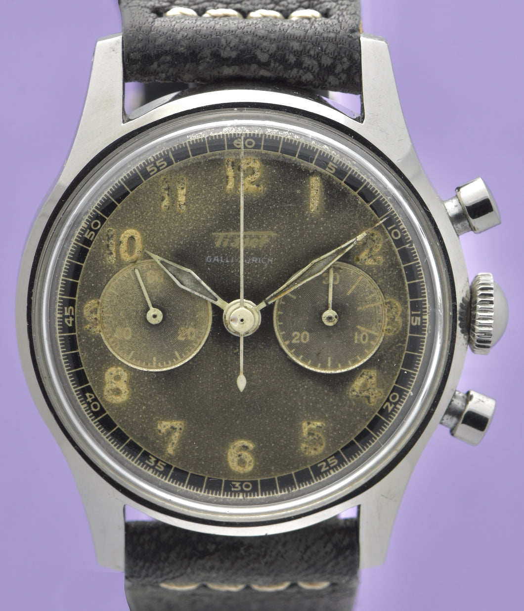Tissot, Ref. No. 6216-3. Made in the 1950s and sold by Galli Uhren in Zürich, Switzerland.  Fine, water resistant, stainless radium dial steel wristwatch with round button chronograph, registers.