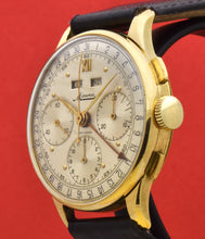 Load image into Gallery viewer, Minerva, triple calendar chronograph, made circa 1955. Dial: Brushed silver with applied Roman numeral at 12 and gold markers, outer minutes and 1/5th seconds track, subsidiary dials for the seconds, the 12-hour and 30-minute registers, apertures for the days of the week and months in French. Thin hands. Signed Minerva.