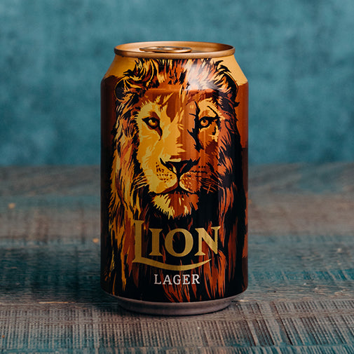 Lion Lager 330ml, A mild Sri Lankabeer, this lager with a lovely golden colour and a hint of fruit and caramel flavour is well-liked for its slight sweetness and tempered hops.