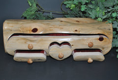 Amish Jewelry log with four drawers and heart drawer in the center