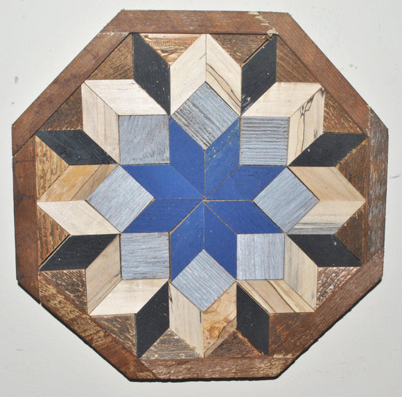 Barn wood quilt in the shape of an octagon with a blue star as the center focal point.