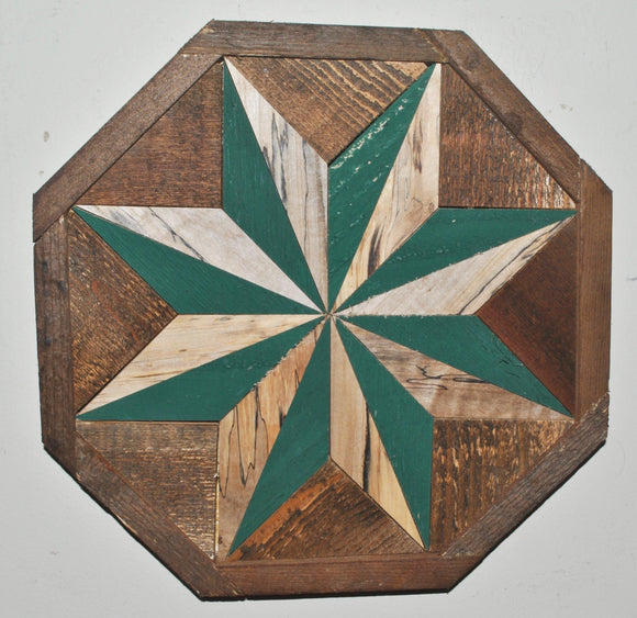 Green and wood star that fills the entire one foot octagon with color and a rustic character. The star is made of elongated triangles and alternates between green and wood