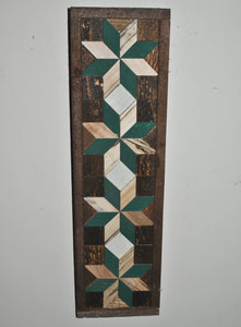 Four stars stacked on top of each other with barn wood as the border and green painted pieces and light wood as the stars in the center.