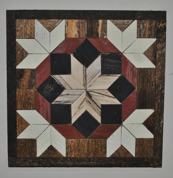 Light wood center star surrounded by black squares and red diamonds that are bordered by white half stars to create a quilt pattern made from barn wood