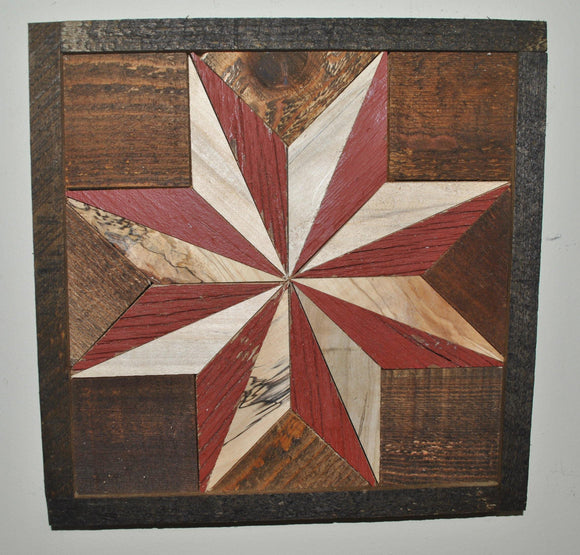 Light wood and red barn wood create a center quilt star that is surrounded by dark barn wood stained in a walnut color